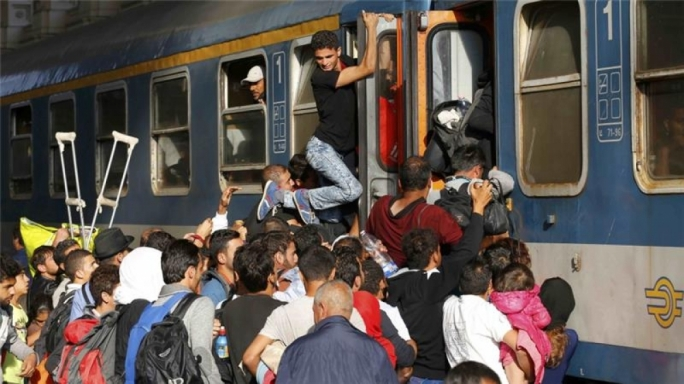 Chaotic scenes in Budapest as refugees are forced off a train at a refugee camp