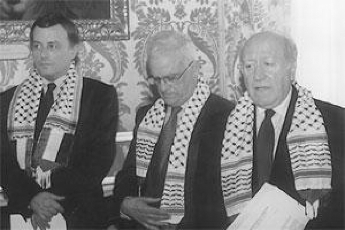 File photo: Alfred Sant, Eddie Fenech Adami and Guido de Marco, wearing the keffiyah, later joined a Palestinian peace march