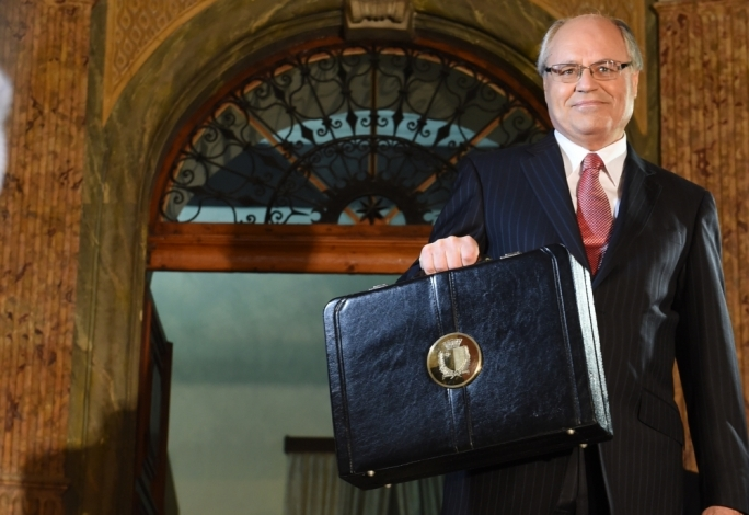 Finance minister Edward Scicluna holding up the Budget case. Photo: Ray Attard