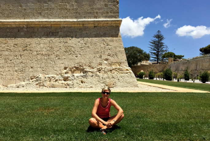 Breaking the law: sitting on the Mdina moat's lawn