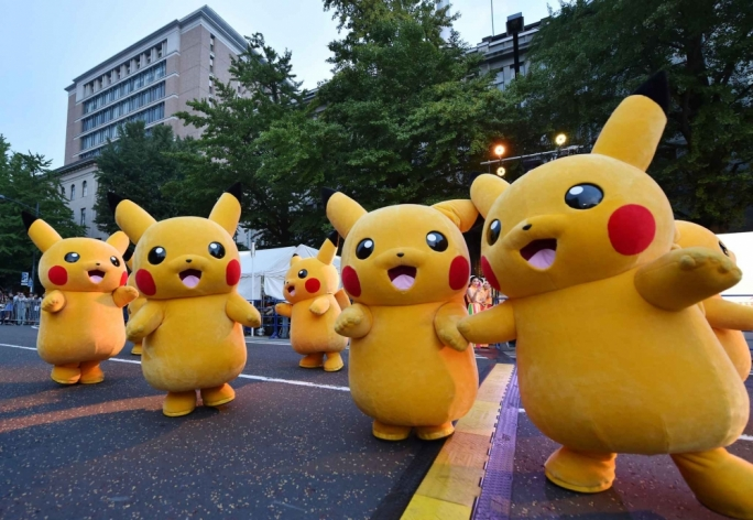 Costumed performers as Pikachu, the popular animation Pokemon series character, perform at the Yokohama Dance Parade in Yokohama, Japan back in August 2015