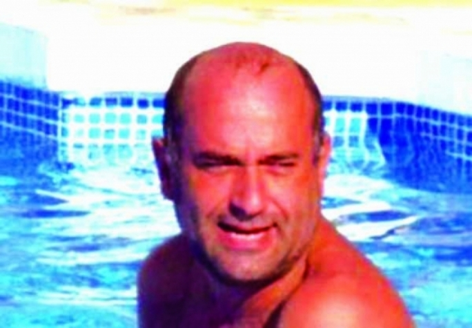 Having a swim: Spiteri at the Surrey home of the mother of his partner Lorna Maltby in a photo he posted on an online dating profile, which enabled The Times to track him down and source his arrest. The couple's consultancy firm is Symphony Global