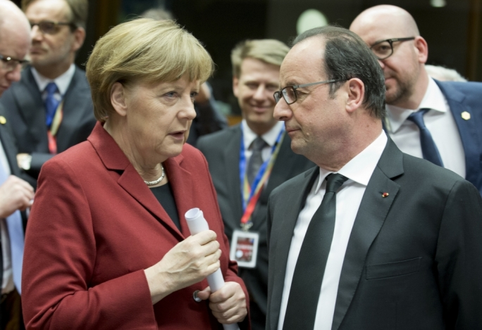 France and Germany call for obligatory refugee quotas