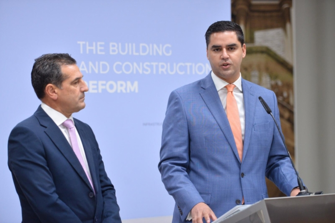 Infrastructure Minister Ian Borg (right), flanked by parliamentary secretary Chris Agius