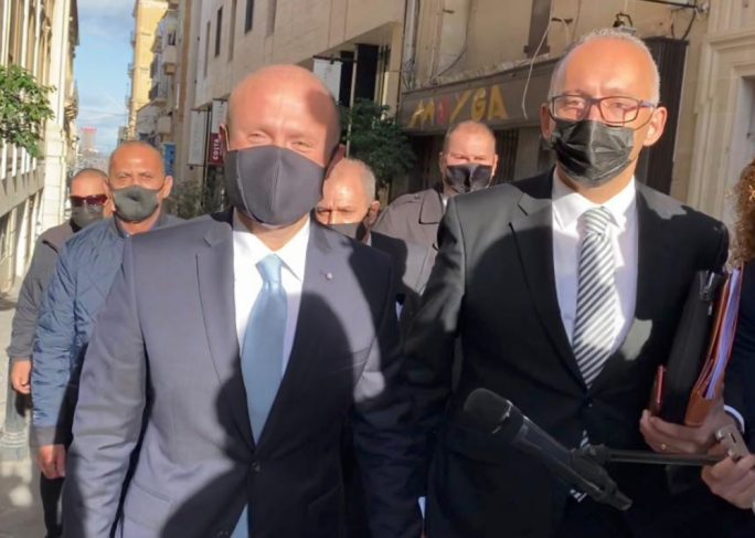 Former prime minister Joseph Muscat entering the law courts in Valletta, accompanied by his lawyer Charlon Gouder, as he prepares to testify in the Daphne Caruana Galizia public inquiry. (Photo: Nicole Meilak/MaltaToday)