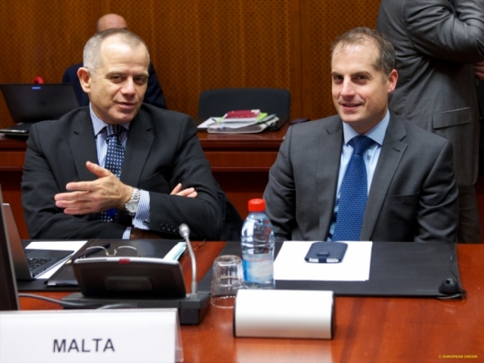 Malta's Deputy Permanent Representative to the EU, Neil Kerr (right)
