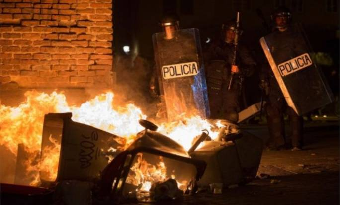 Madrid migrants clash with police following street vendor's death