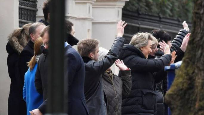 Embassy staff waved to the Russian diplomats as they leave