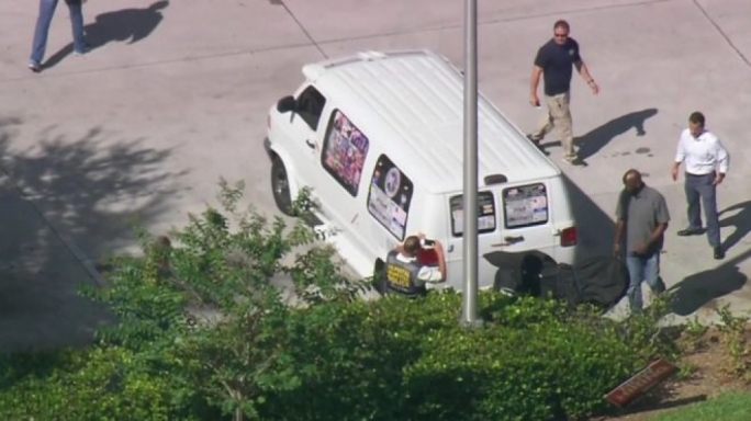 A van belonging to the suspect being checked by police (Source: CBS)
