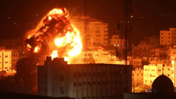 Flames and smoke are seen during an Israeli air raid in Gaza City