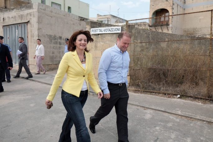 Joseph Muscat and his wife Michelle emerge from the Burmarrad polling station on Saturday (Photo: Chris Mangion)