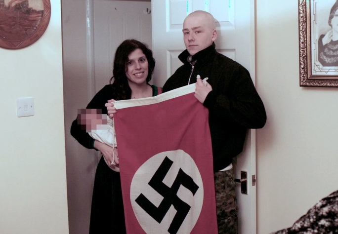 Happy family: Claudia Patatas and Adam Thomas pose with their son, whose middle name is Adolf.