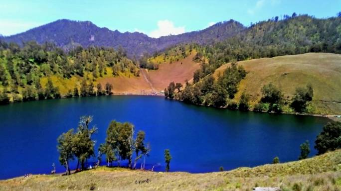 Spend the night in a tent at Ranu Kumbolo on Java island and wake up to the most incredible views of the lake