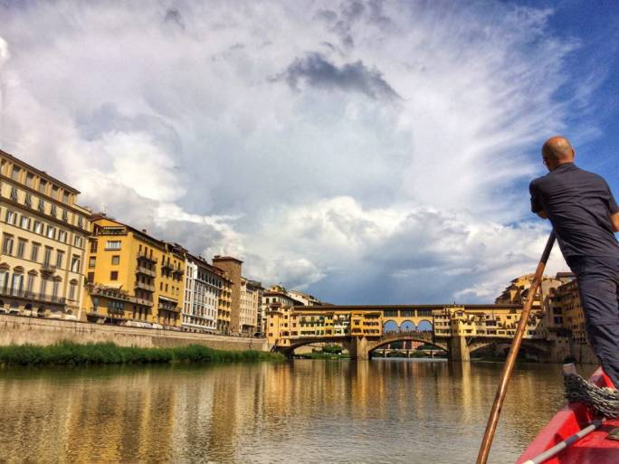 Get a unique view of the city of while rafting along the River Arno