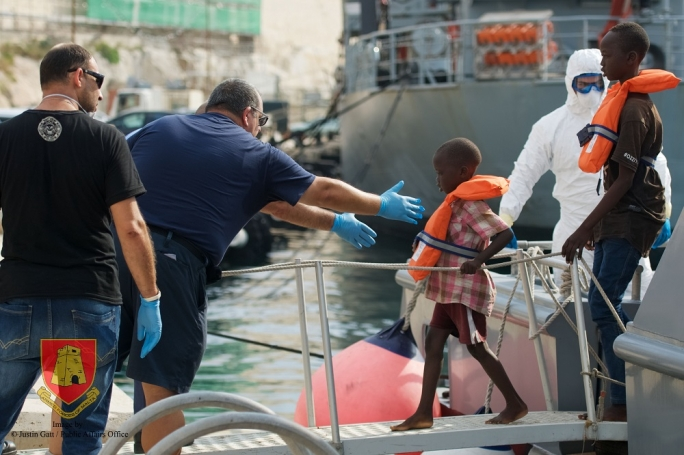 A child walks down the gangway after the Armed Forces of Malta rescued 114 migrants at sea (Photo: AFM)