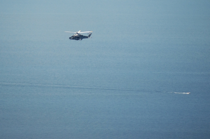 AFM helicopter flying over the sea off Dingli Cliffs
