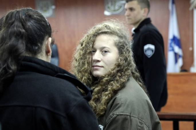 Ahed Tamimi escorted into the court.