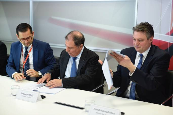 In 2018, a collective agreement between the pilots association and government was signed. Photo shows tourism minister Konrad Mizzi (right)