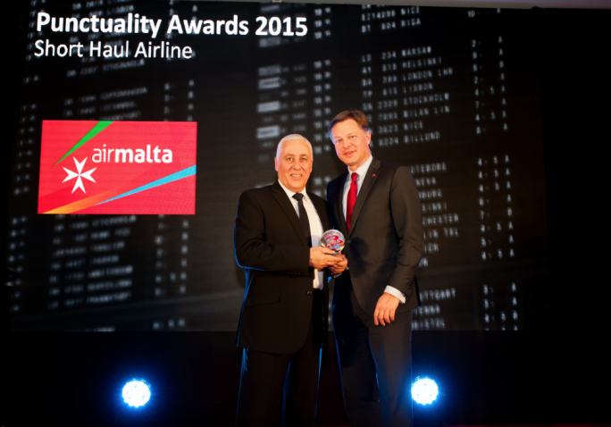 ngelo Sciberras - Air Malta's Market Manager for France, Benelux & Swiss Romande receiving the award from Brussels Airport CEO Mr. Arnaud Feist. Photo: Stef Boey – Brussels Airport Company.
