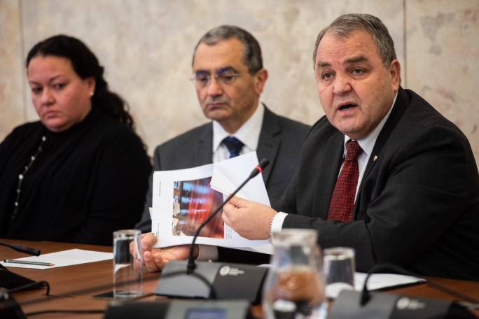 Speaker of the House, Anglu Farrugia, showing the press photographs of the deterioration of certain areas inside the Parliament building in Valletta. (Photo: James Bianchi/MediaToday)