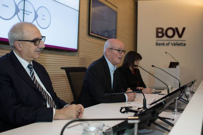 Bank of Valletta chairman Deo Scerri (centre) presents the bank's results to the media