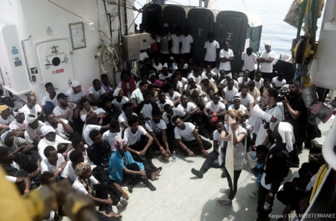 Migrants aboard the Aquarius being told of their situation on Monday