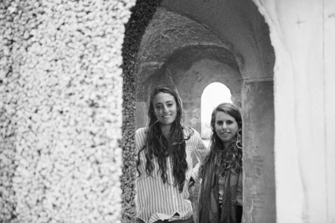 Lucia Calleja (left) and Katrina Gauci (right) standing inside the pavilion