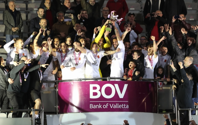 Valletta's players celebrating their triumph. Photo: Dominic Borg