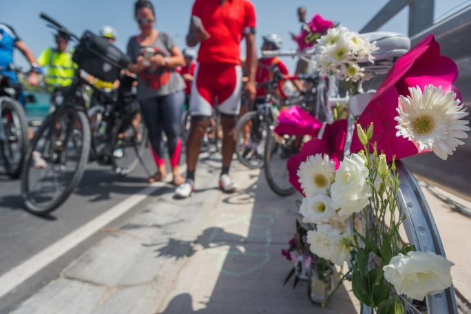 Members of the Bicycle Advocacy Group placed flowers at a ghost bike in memory of Zoran Pavlovic who was killed while riding his bike last week