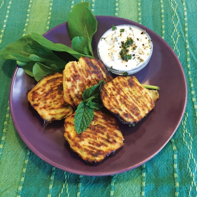 Gluten-free baked zucchini fritters with yoghurt dressing