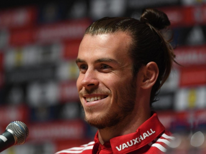 Garteth Bale facing the media at Wales' Dinard training camp