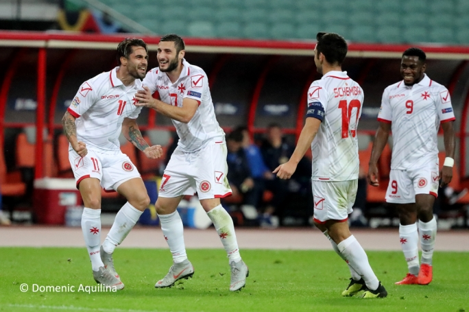 Rowen Muscat celebrating with team mates after scoring for Malta. Photo: Dominic Aquilina / MFA