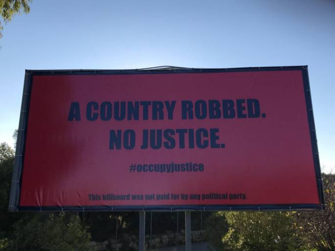 One of the billboards erected by Occupy Justice campaigners after the death of journalist Daphne Caruana Galizia