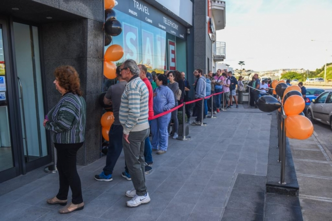 The Scan outlet anticipated its opening time as customers queued outside the Birkirkara outlet for tech items