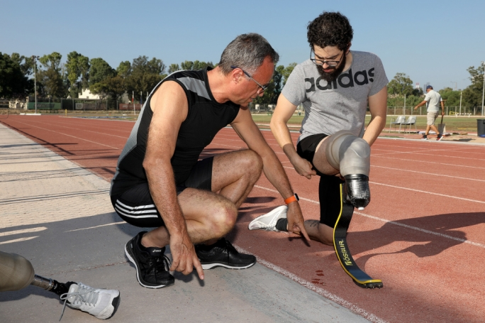 Antonio Flores (right) showing Paolo Catalfamo his latest acquisition — a sprint specific blade, which he has been training with and which he hopes will help secure him a spot in Tokyo 2020