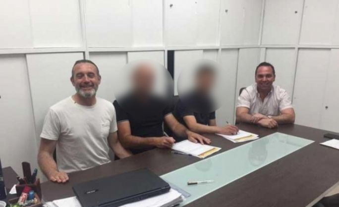 Darren Debono (left) at the table of Senglea's executive committee, with property entrepreneur Reuben Debono (right)
