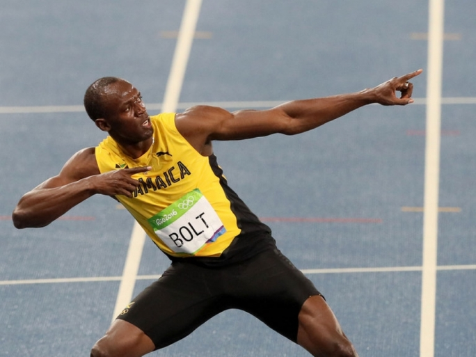 Jamaica's Usain Bolt celebrates winning the 200m