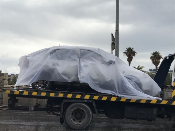 At 12.30pm, the Opel Astra was loaded onto a Police loader truck for transportation to Headquarters for further examination