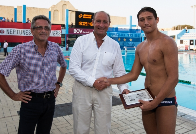 Sirens' goalkeeper Nicholas Grixti (R) receiving the award from Paul Gauci, Executive Head BOV Training and Education from Bank of Valletta and Joe Caruana Curran, President of the Aquatic Sports Association of Malta