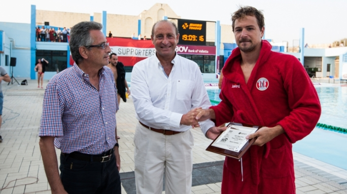 Stevie Camilleri of Neptunes Grimaldi receiving the award from Paul Gauci, Executive Head BOV Training and Education from Bank of Valletta and Joe Caruana Curran, President of the Aquatic Sports Association of Malta