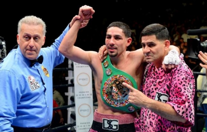 Danny Garcia, pumps his fist after defeating Robert Guerrero (not pictured) during their WBC welterweight boxing title fight at Staples Center. Garcia won by decision.