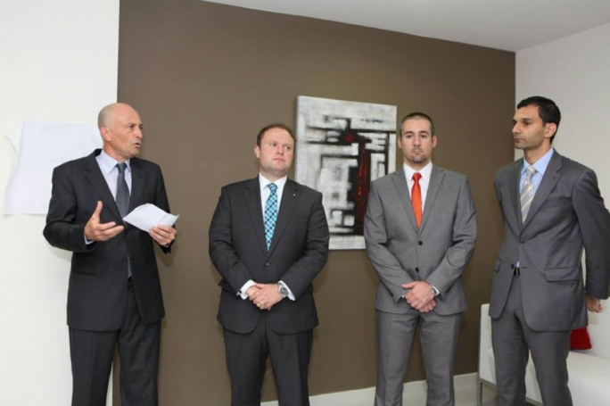 Brian Tonna (left) at the inauguration of Nexia BT's offices, with then prime minister Joseph Muscat and partners Karl Cini and Manuel Castagna (File photo)