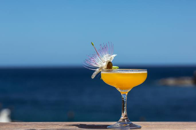 Cocktails and sea views at Corinthia St. George's Broadside Terrace