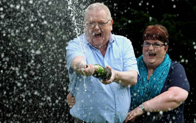 "Colin and Chris Weir from Ayrshire said they were ""tickled pink"" after winning the EuroMillions £161,653,000 jackpot in July 2011"