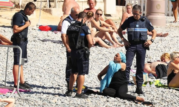 French police force woman to strip off burkini on Nice beach