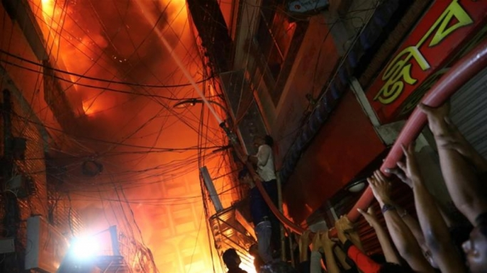 The flames raced through four adjoining buildings, which were also used as chemical warehouses