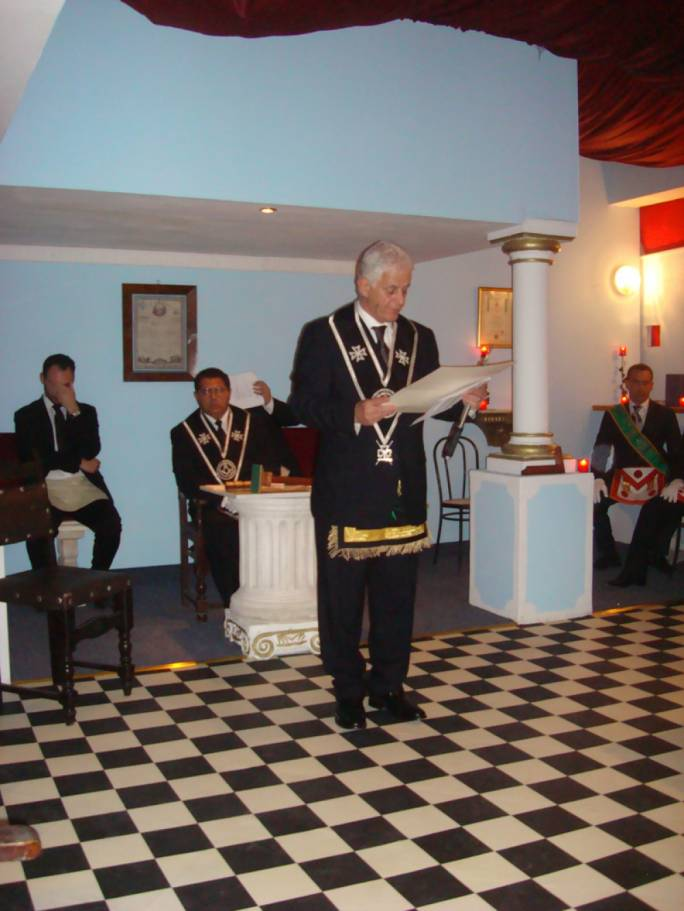 Photo shows Arthur Azzopardi (left) at a Malta Grand Lodge meeting being addressed by Mario Vella Gatt