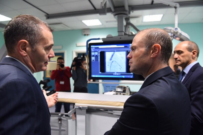Cardiology chairperson Robert Xuereb (left) explaining the work done by doctors at Mater Dei's cardiac suites to Prime Minister Joseph Muscat
