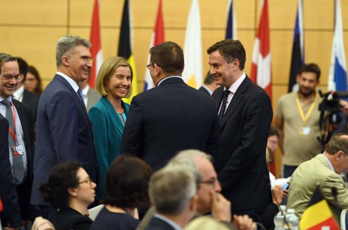 Minister Carmelo Abela (left) with the EU's High Representative for Foreign and Security Policy, Federica Mogherini, and other officials at the conference