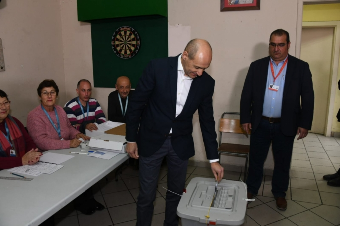 Chris Fearne casting his vote at the Fgura party club